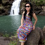 Wearing an authentic ethnic dress while traveling to the Waimea Falls